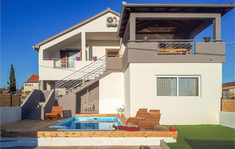 Holiday apartment with 3 bedrooms on 80m² in Tinj