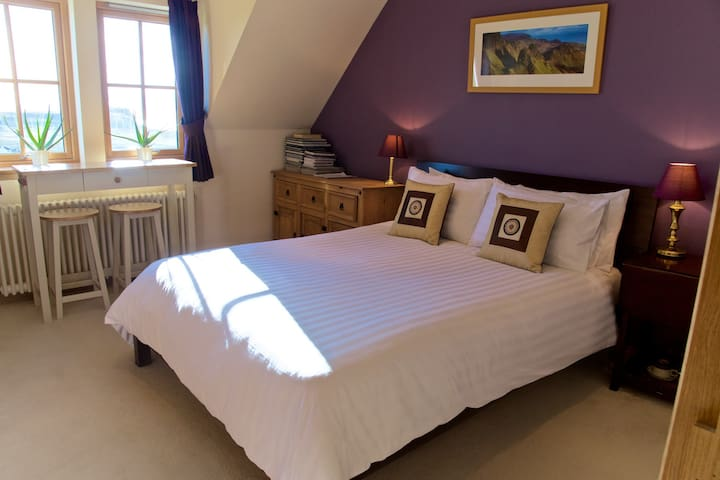 Luxury king size bedroom with stunning seaview