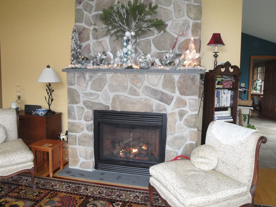 Cozy sitting room for lounging near the gas fireplace, playing games, or reading.