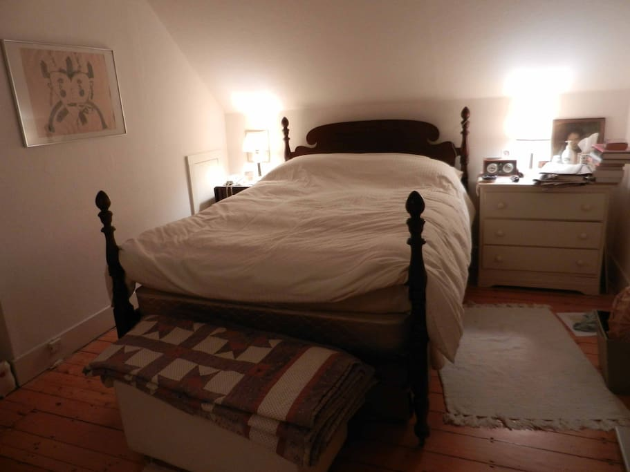 10'x12' master bedroom with full size bed- down comforter in winter.
