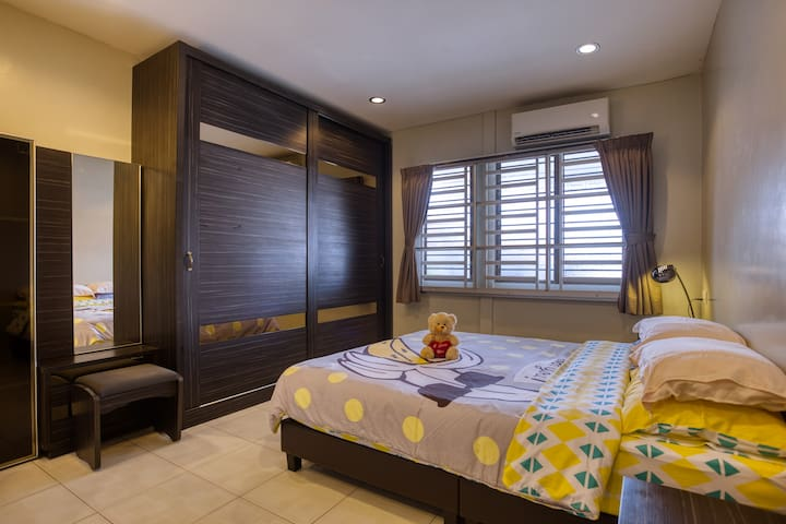 The master-bed room with a queen size bed and air condition.