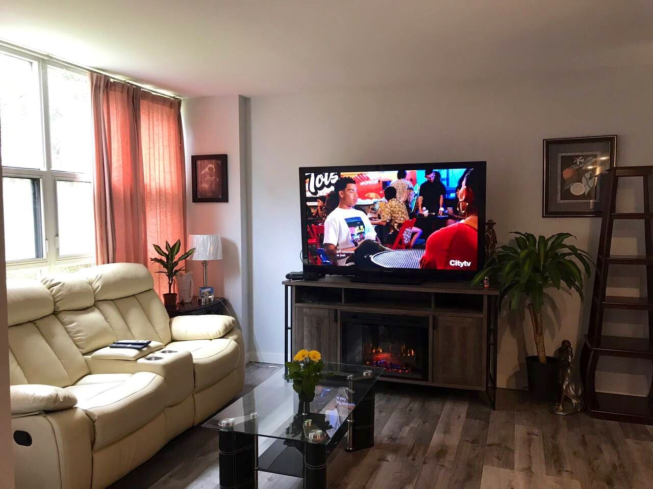 60 inch Smart TV, indoor fireplace with 2 reclining sofa (coach) in living room