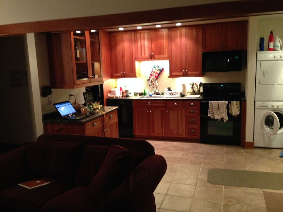 Kitchen area with washer and dryer