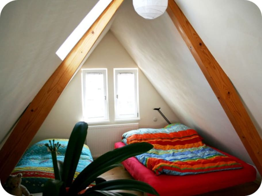 The bedroom is located in the second floor roof-studio