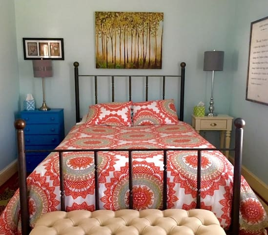 Comfortable queen bedroom with ample storage space and natural light.