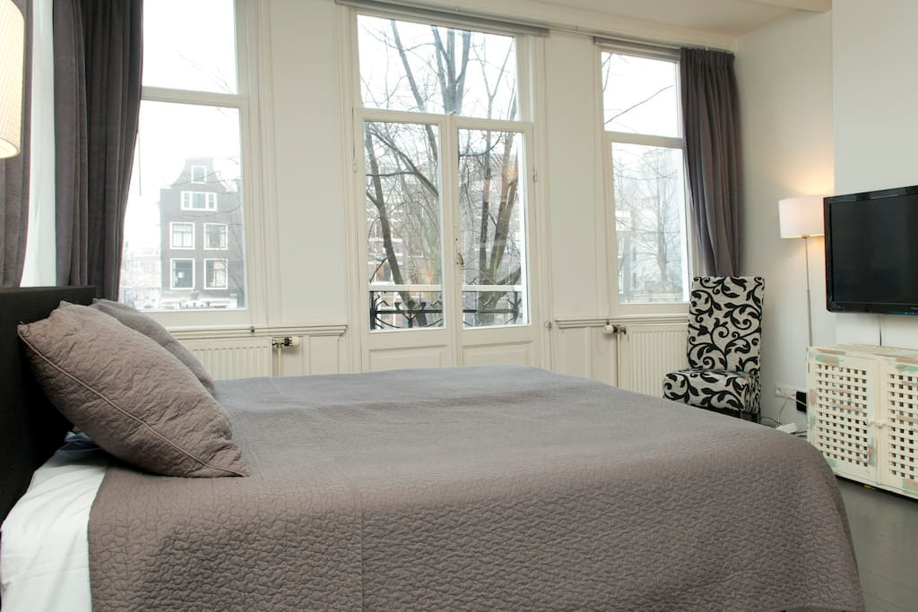 Beautiful bedroom with an incredible view of the canal