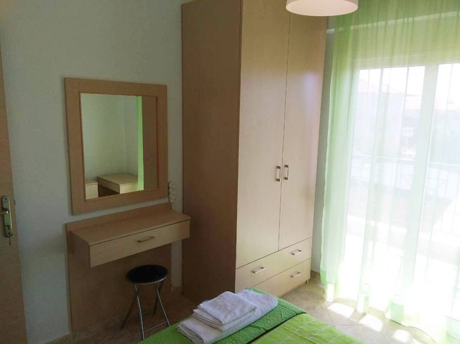 Room1: Eastern orientation, bright mornings, cool afternoons. Double wardrobe, dressing table. Access to backside balcony for laundry.