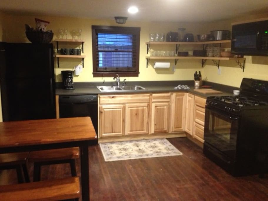 Brand new kitchen with ice maker and garbage disposal.