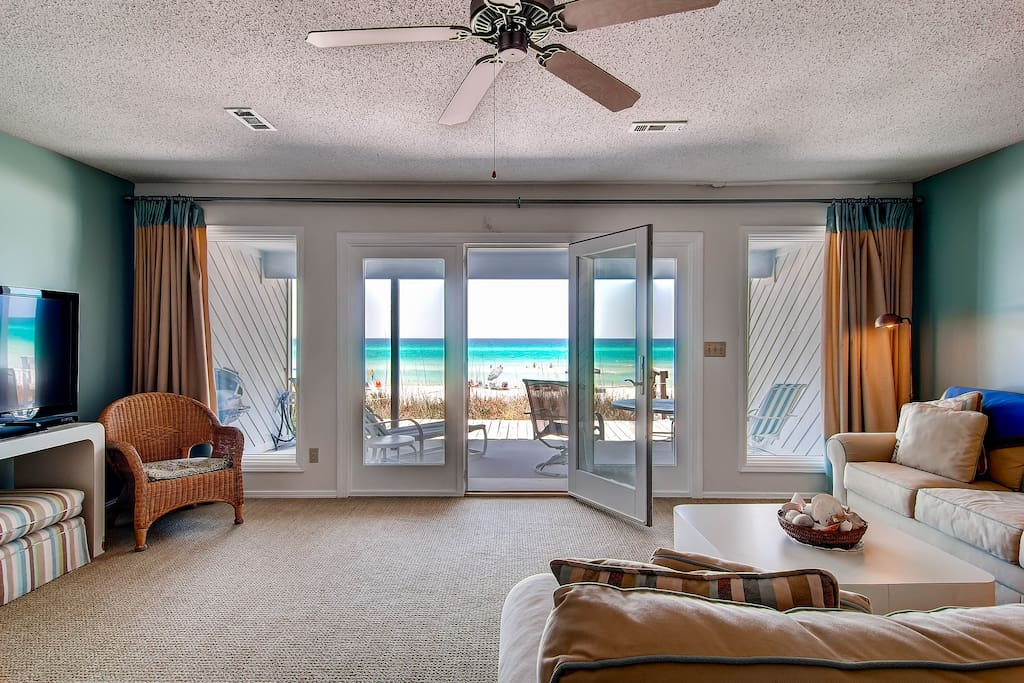 The living room has a flatscreen TV or you could just stare at the beach.