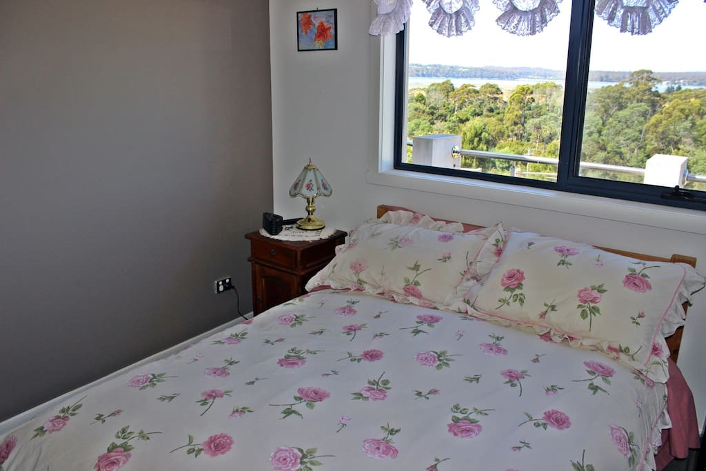 Room features double bed and flatscreen TV