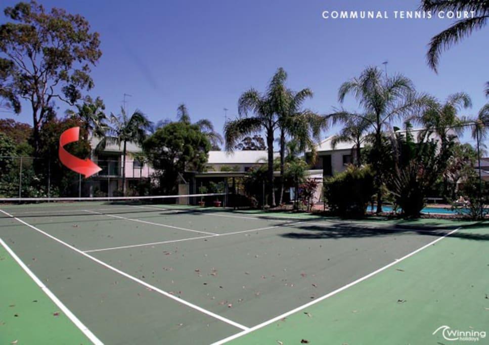Apartment overlooks tennis court