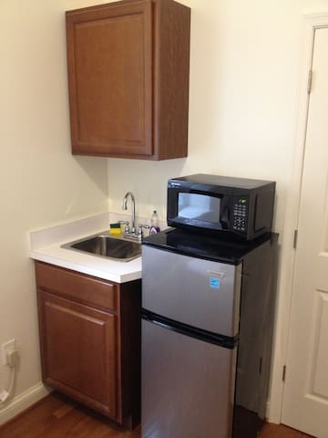 Fully equipped kitchenette with sink, frig/freezer and microwave.