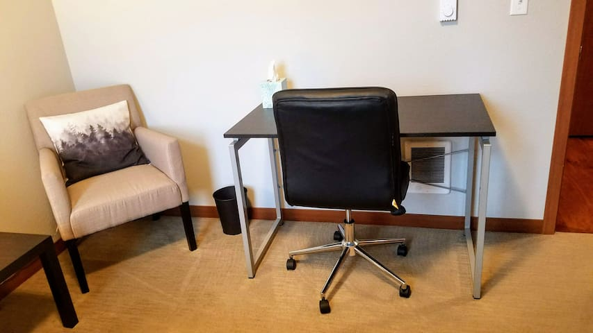 Comfortable leather chair and a sturdy desk.