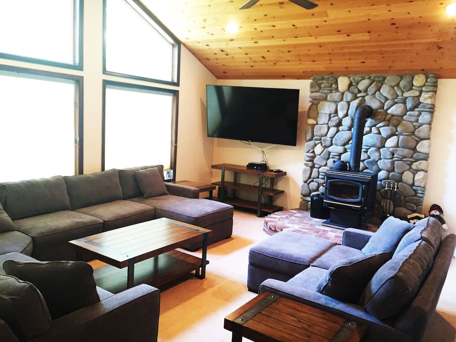 "Living Room with wood burning fireplace, 75"" TV"