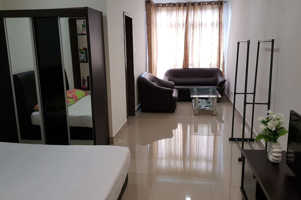 Studio Room with Queen Size bed and sofa set, TV and air-conditioner
