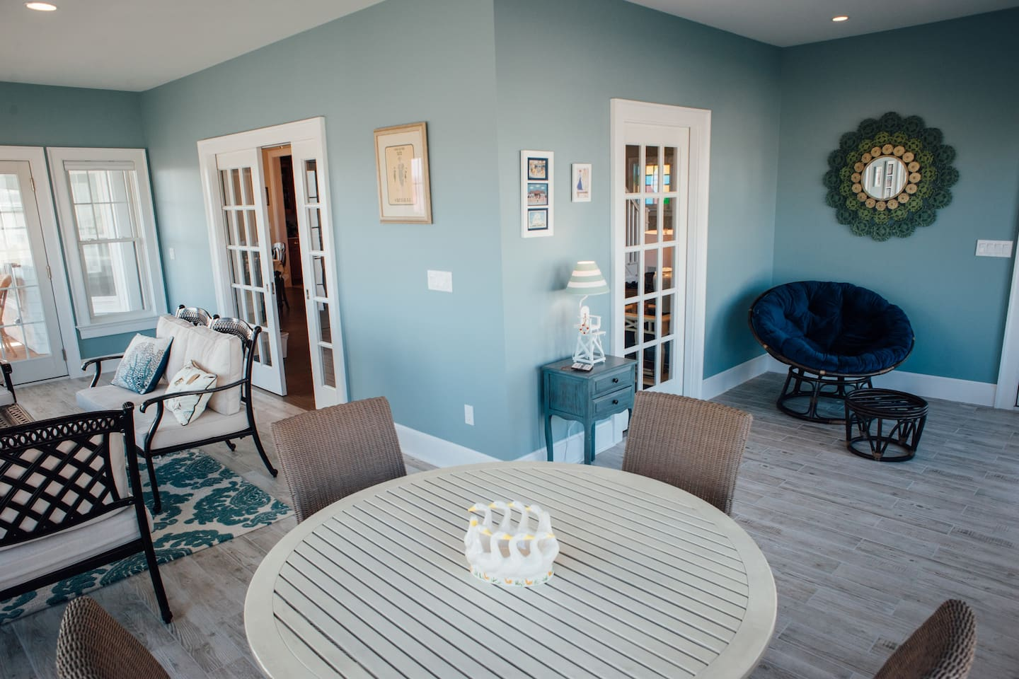 Our favorite spot: enjoy views of the sand and street from the beautiful enclosed porch.