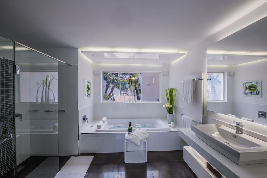 The bathroom with a whirlpool tub and shower is spacious and luxurious.