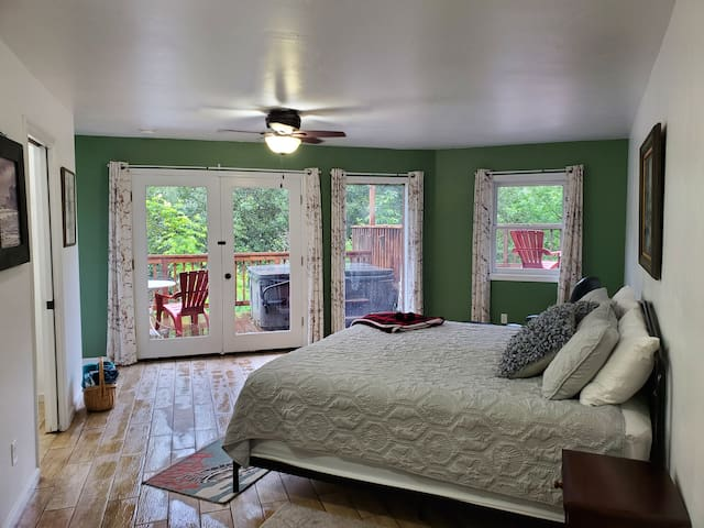 Lower level Main bedroom with on-suite.  View out to deck