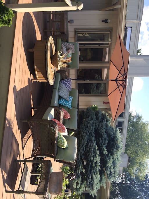 Enjoy a drink or morning coffee on the deck overlooking the gardens.