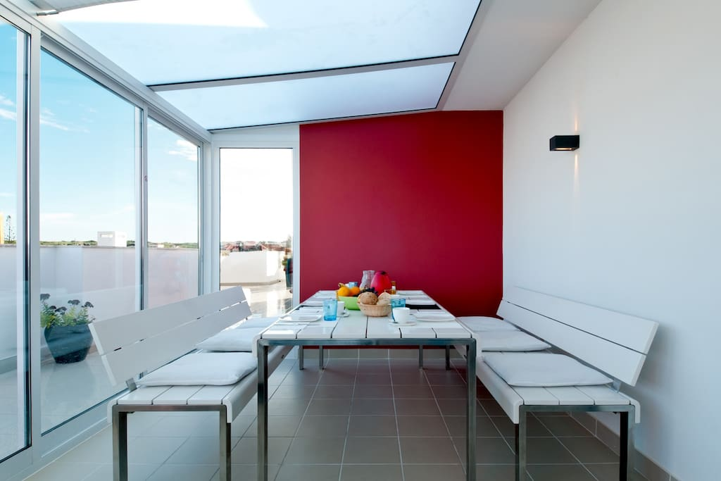 large dining table in the veranda