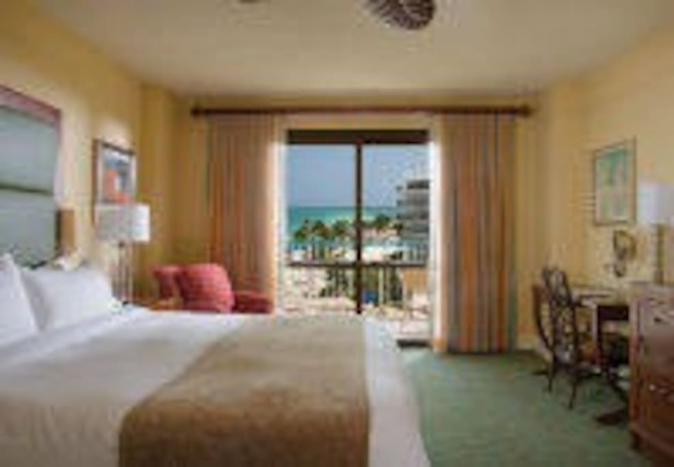 Villa Master Bedroom - Oceanside  Relax and unwind in your luxurious master bedroom after a day on the beach.