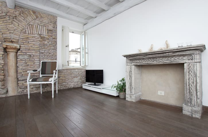 the studio has got a very beautiful parquet and a charming wooden ceiling
