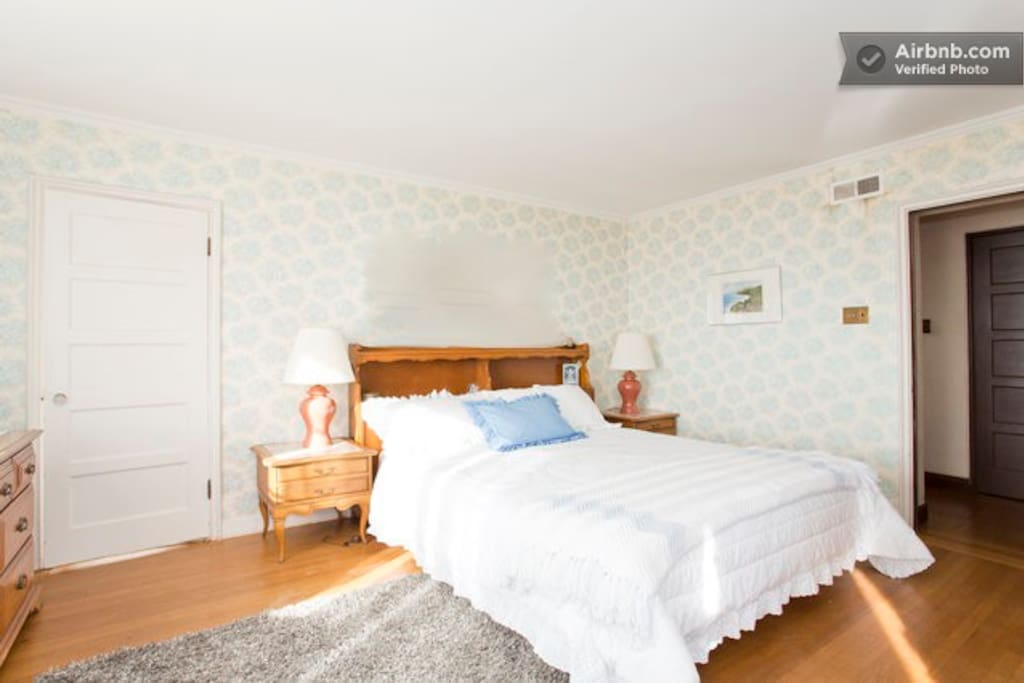 This large bedroom with a California King bed and comfy sheets. It is a bright room with 8 windows that overlook the West Coast of SF and the Pacific Ocean.