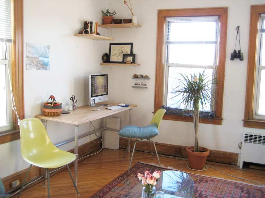 Custom made desk with vintage eames chairs