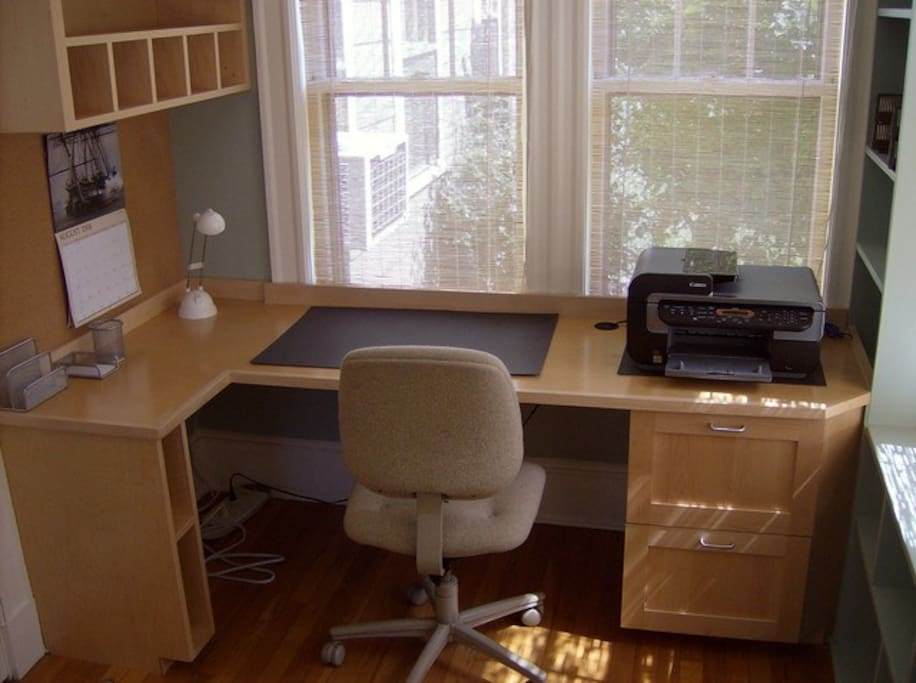 The study offers a built-in desk, color printer/scanner/copier and a comfortable reading chair (not shown) with windows on 3 sides overlooking the garden.