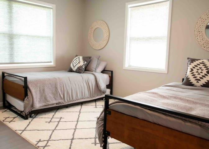 This bedroom has (3) three twin beds in total ( one of the beds is a trundle bed and has another twin bed that easily slides out)