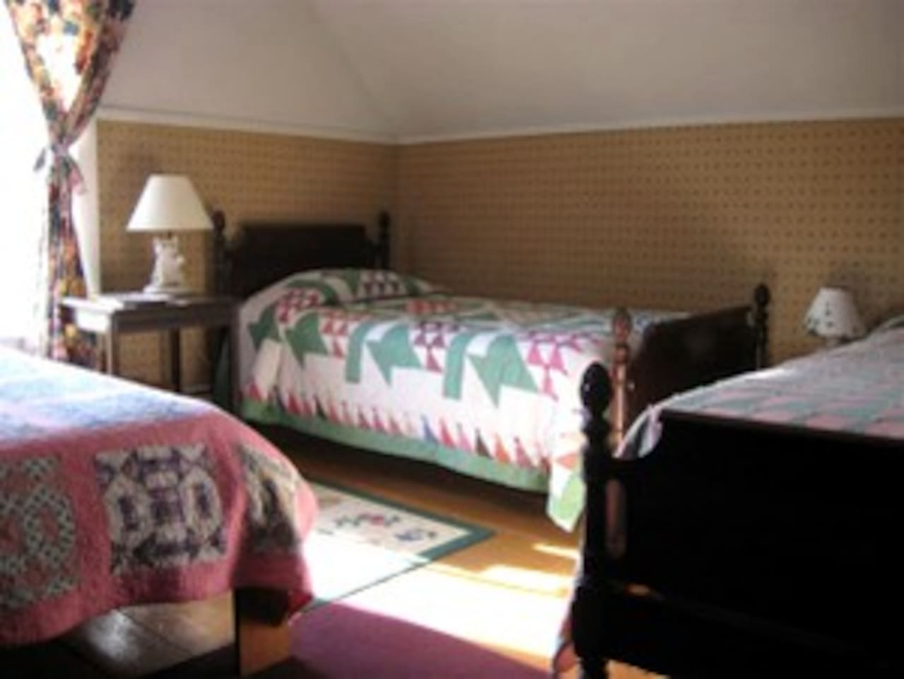 This room is on the second floor, and has one full bed and two twin beds.
