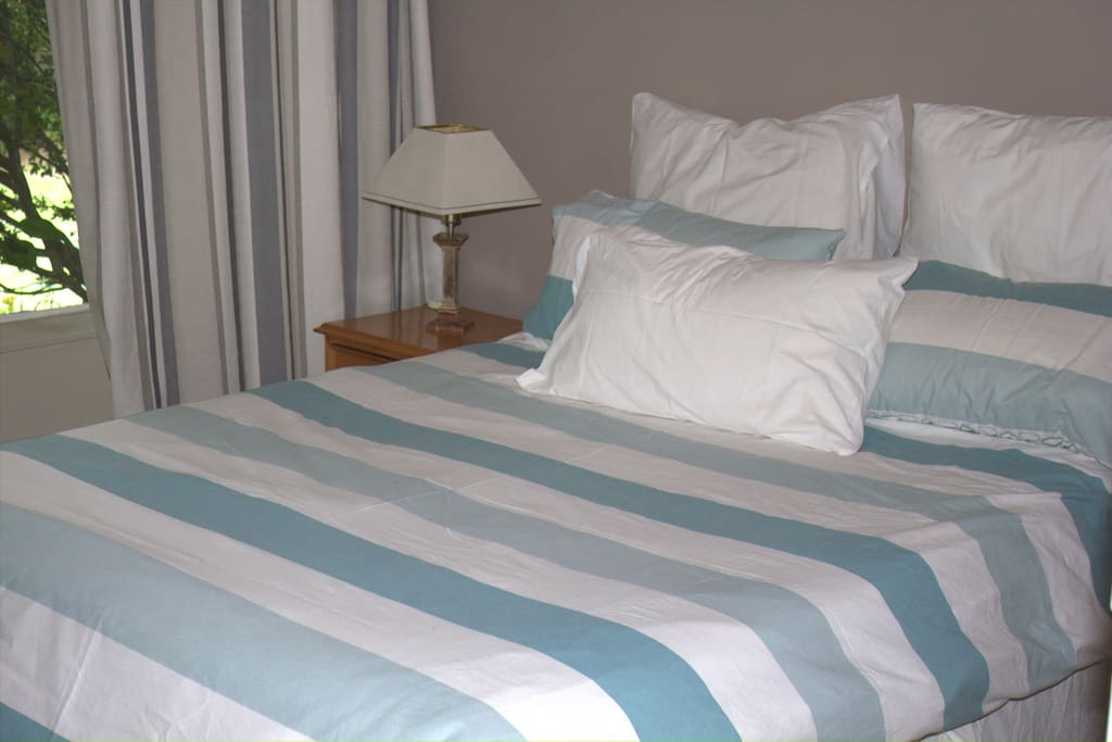 Cool comfortable double room with a view onto a beautiful tropical garden with swimming pool . Sleeps 2 persons sharing.
