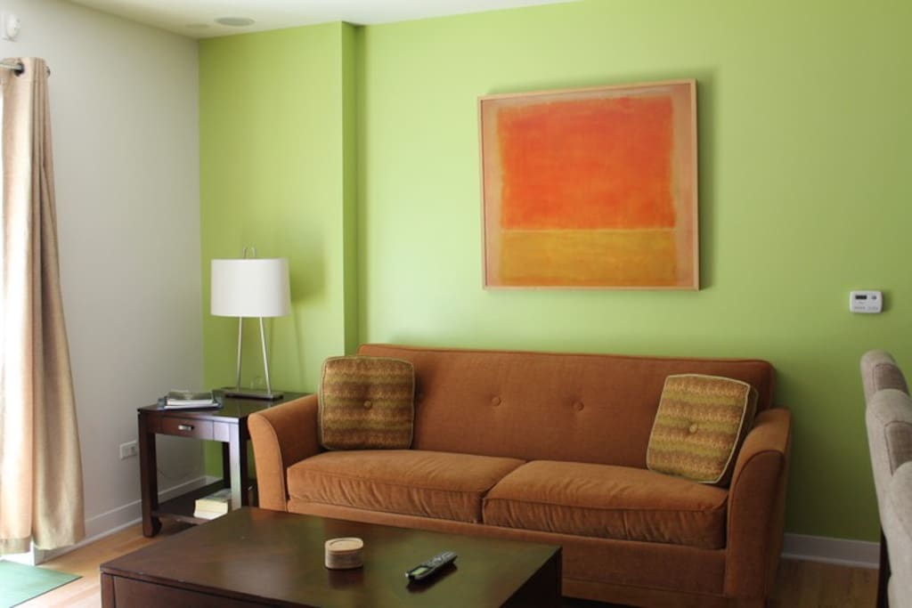Sunny spacious living room with queen size pullout couch and surround sound.