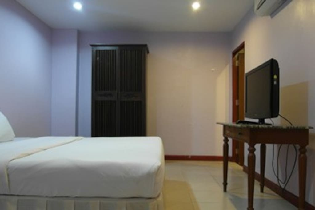 bedroom with airconditioner and TV