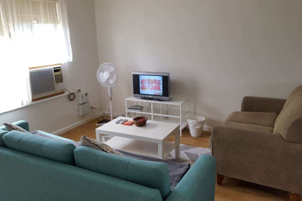 Living Room with TV and Sofa