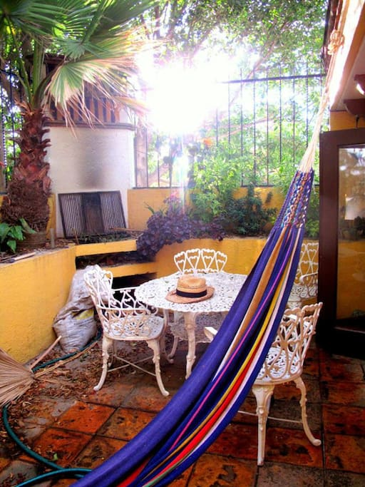 The terrace. You can use the hammock and the grill in the back.