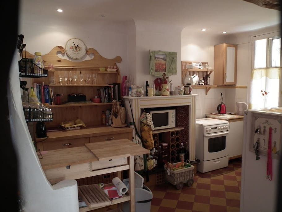 compact - but has large fridge/freezer, flatbed combi-microwave, gas cooker