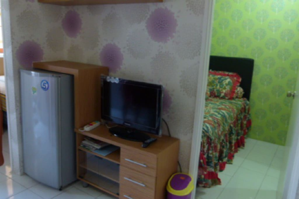 Living room equipped with AC, 40 channel TV and fridge