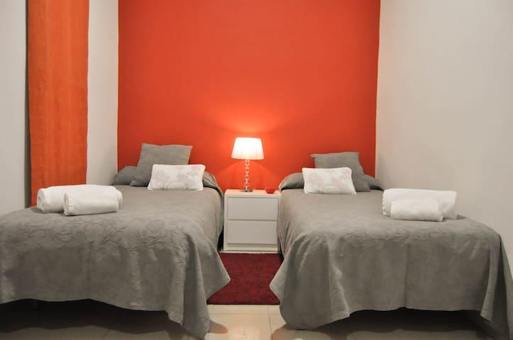 The grey&orange bedroom