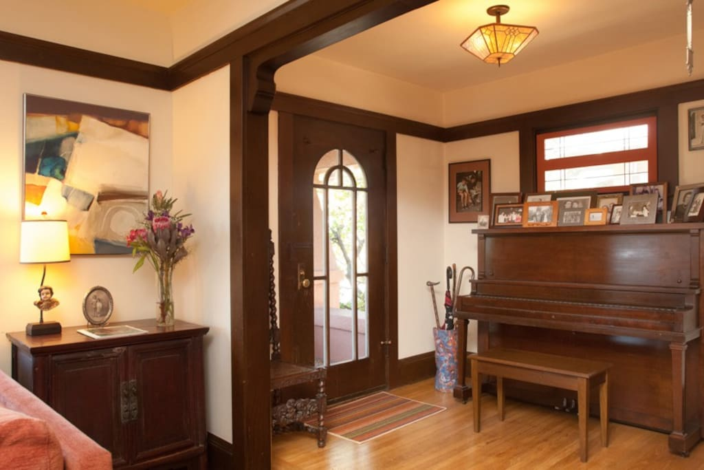 Entry foyer with a piano.
