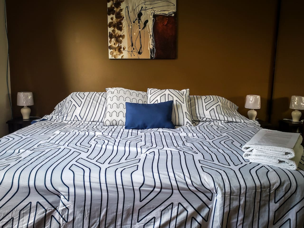 King size Bed with 2 towels and Instructions.