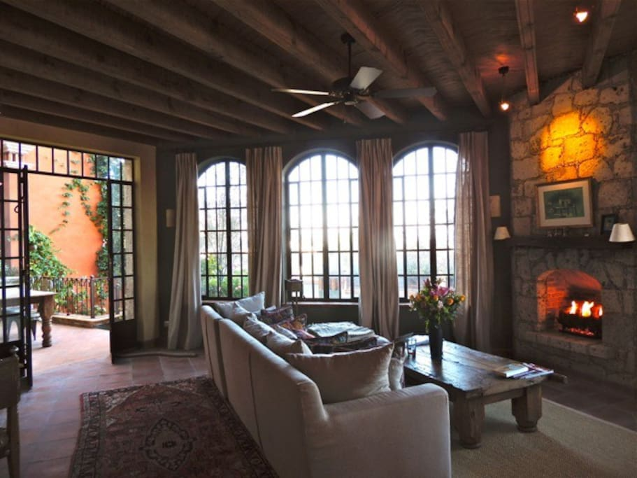 living room with gas burning fireplace