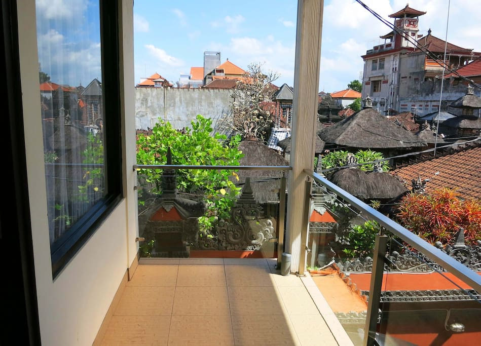View from the first floor of Kuta EcoStay over the local Balinese community