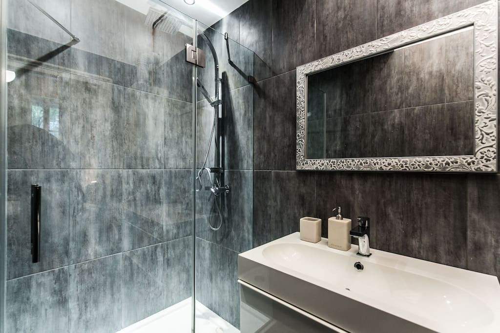 The bathroom with a shower