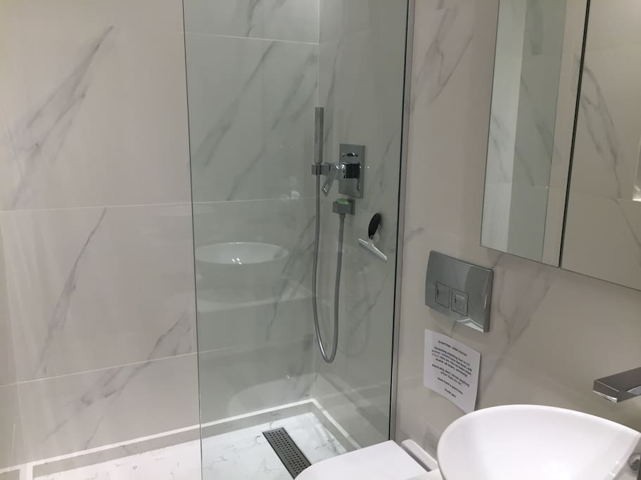 En-suite, private shower room. Silestone shower, loo, wash basin, mirrored cupboard, heated towel rail, shaver sockets.