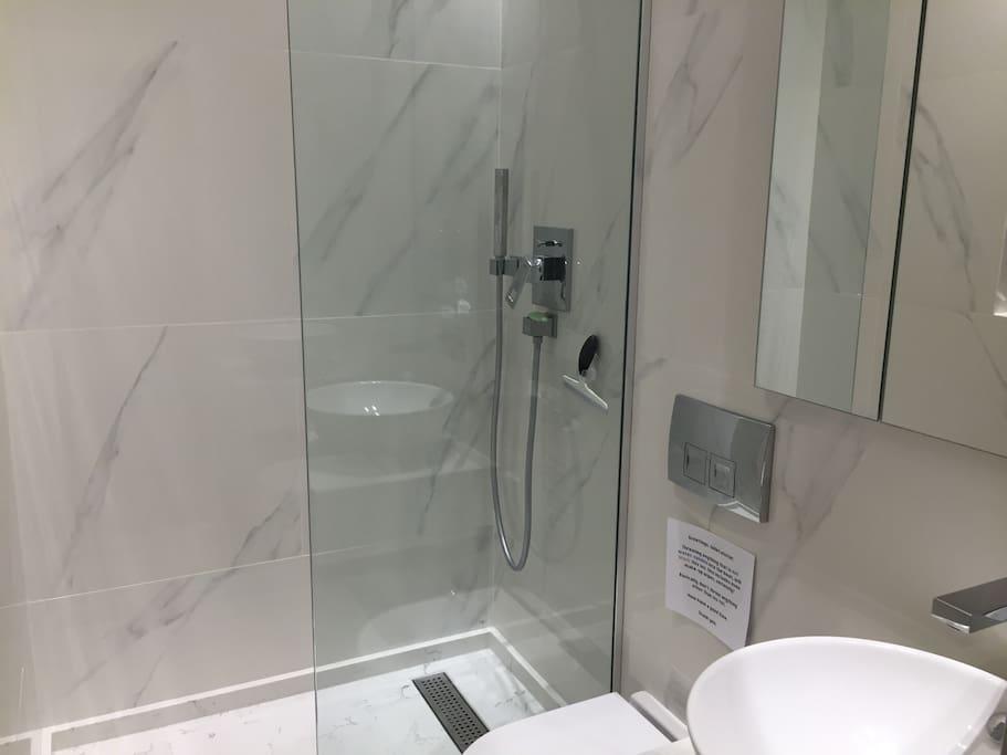 En-suite, private shower room. Silestone shower, loo, wash basin, mirrored cupboard, heated towel rail, shaver sockets.