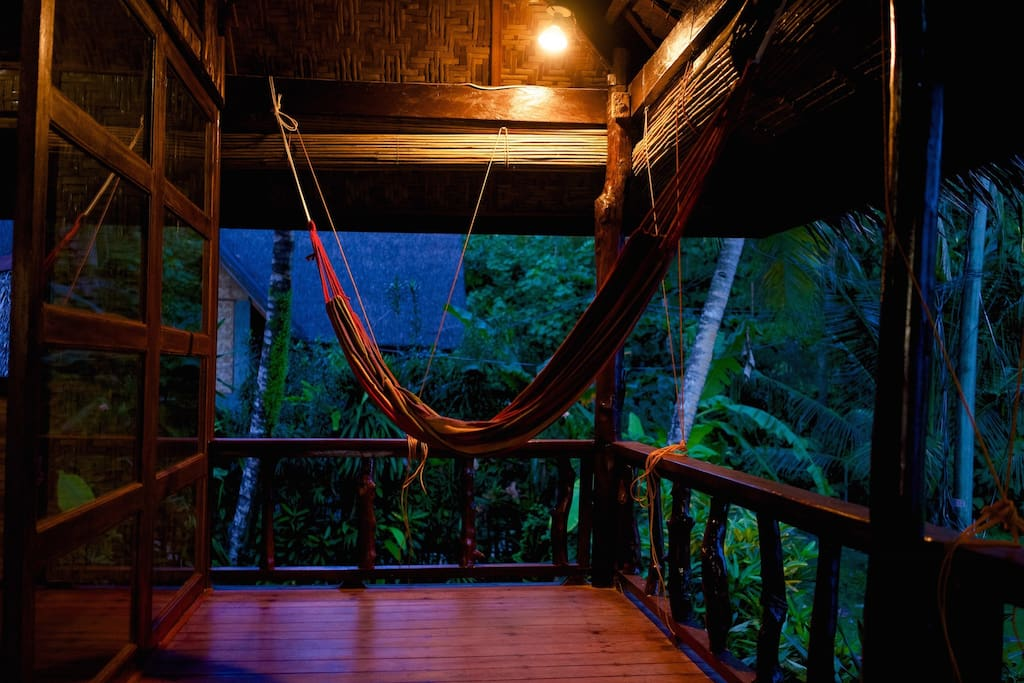 Exterior balcony with a hammock