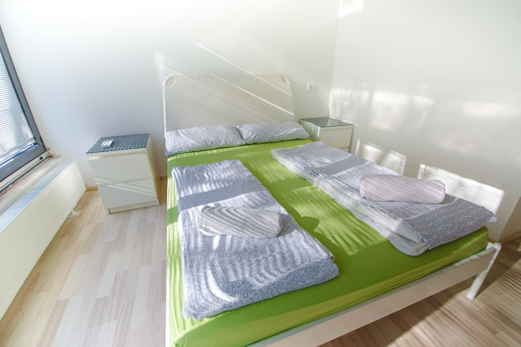 The room with the double bed in the second floor.