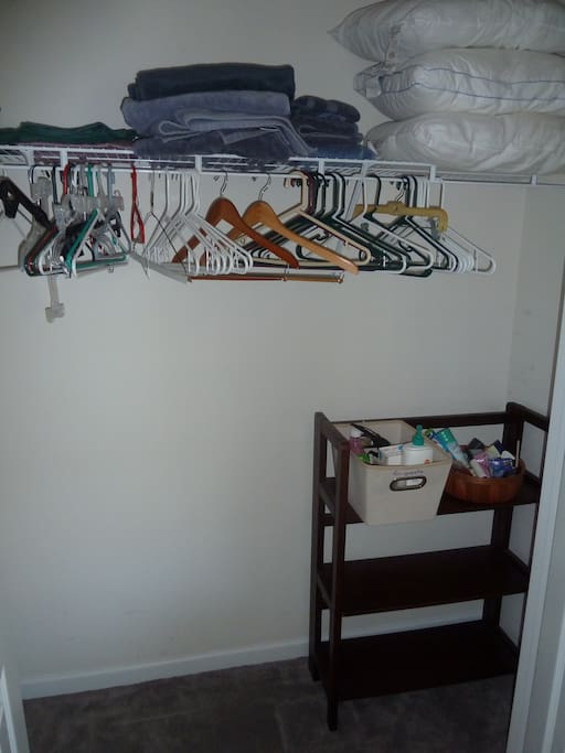 Large closet filled with hangers, extra linens & pillows, and any toiletries you might have forgetten.