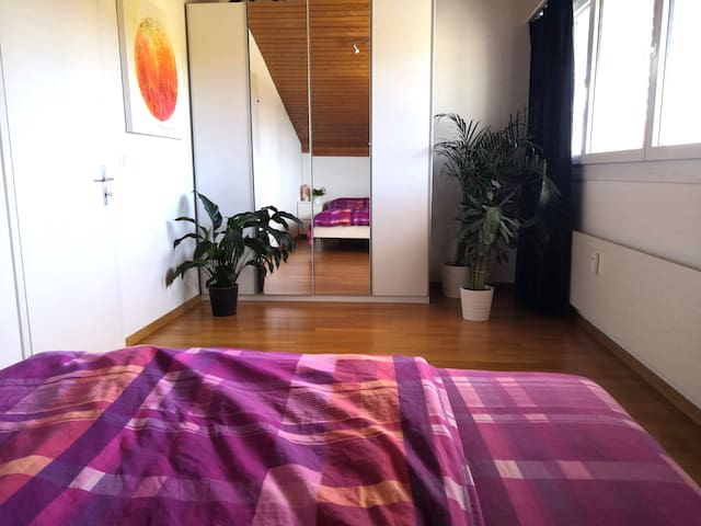 Bedroom with a very comfortable queen-size bed and blackout curtains